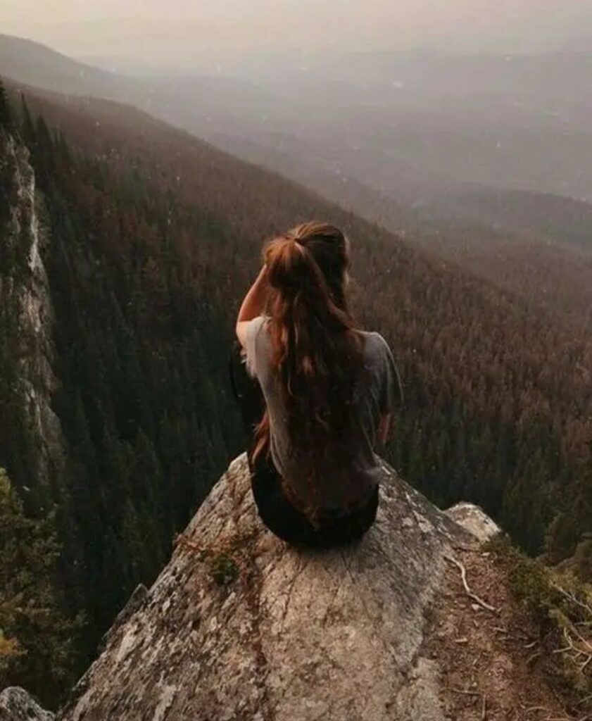 Alone girl sitting on mountain hill very sad Pic Download